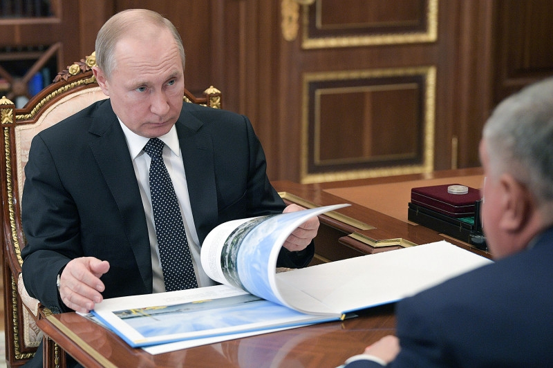 From Ostentatious Parade To Fraudulent Vote, Putin Tries to Cement His Crumbling Rule