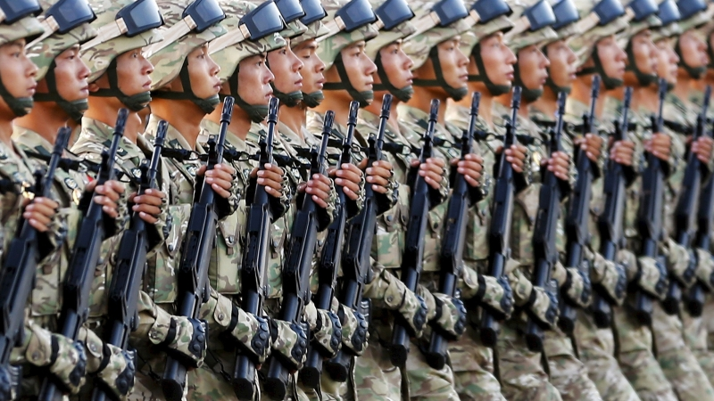 In Central Asia's Forbidding Highlands, A Quiet Newcomer: Chinese Troops